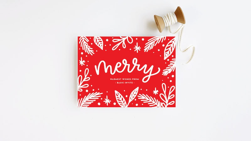 """Red holiday card with the word """"merry""""."""