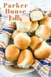 "A basket full of dinner rolls with the words ""Parker house rolls"""