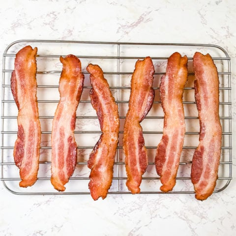 Air fryer bacon on a cooling rack.