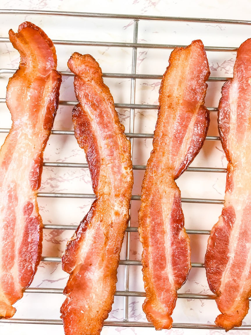 Close up of air fryer bacon on a cooling rack.