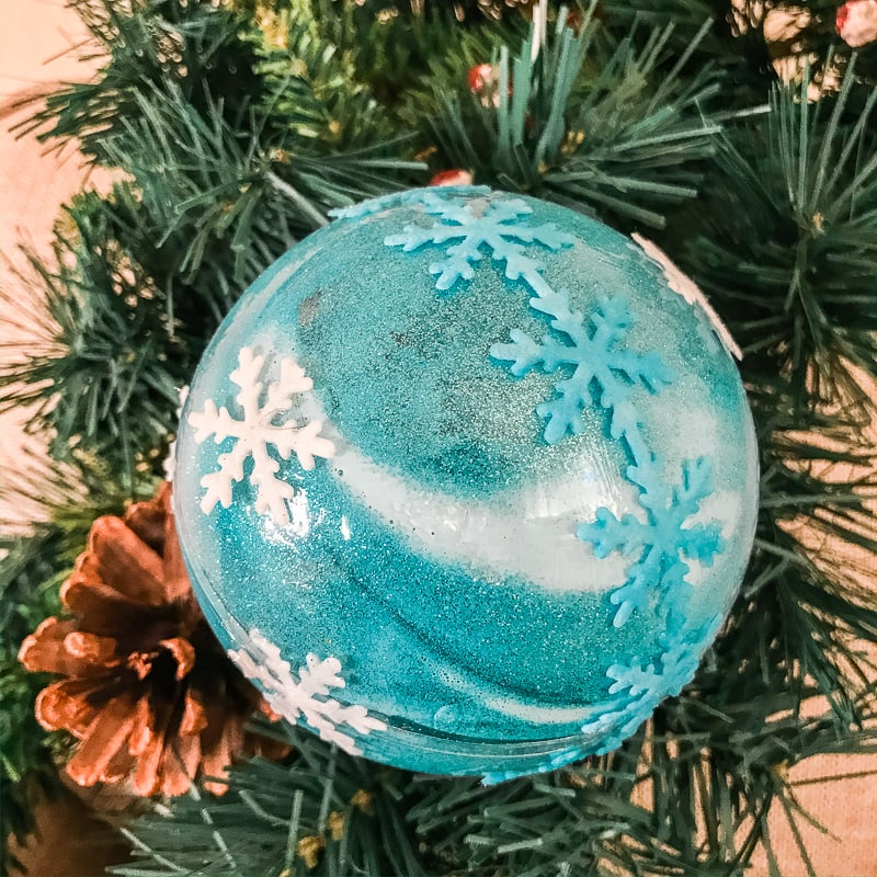 Frozen inspired glitter ornament hanging on a tree
