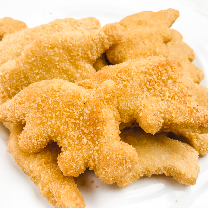 Close up of Dino-shaped air fryer frozen chicken nuggets.