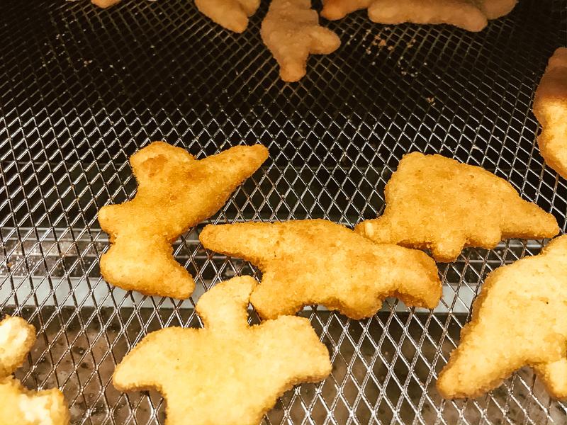 Chicken nuggets inside air fryer.