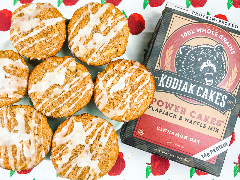 A box of Kodiak Cakes mix next to 7 glazed apple cinnamon muffins.