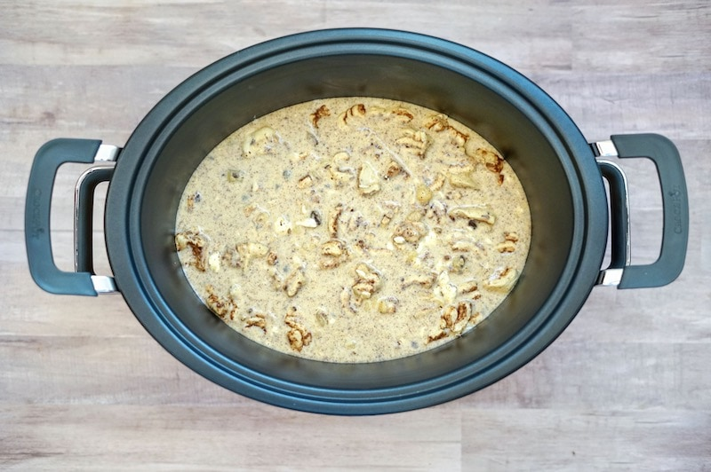 Casserole ingredients in side crockpot.