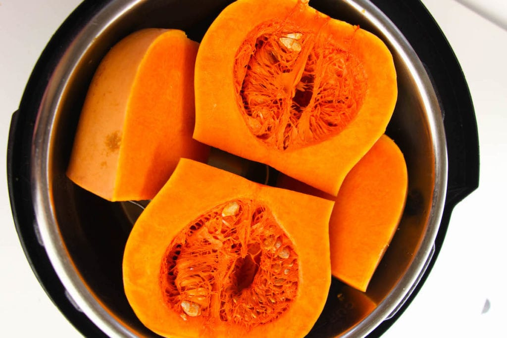 Instant pot with butternut squash inside.