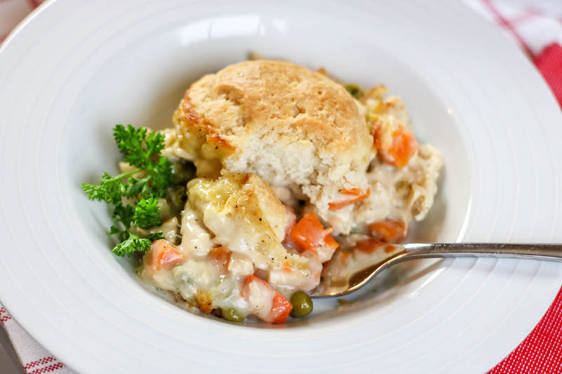 A bite of chicken pot pie on a fork.