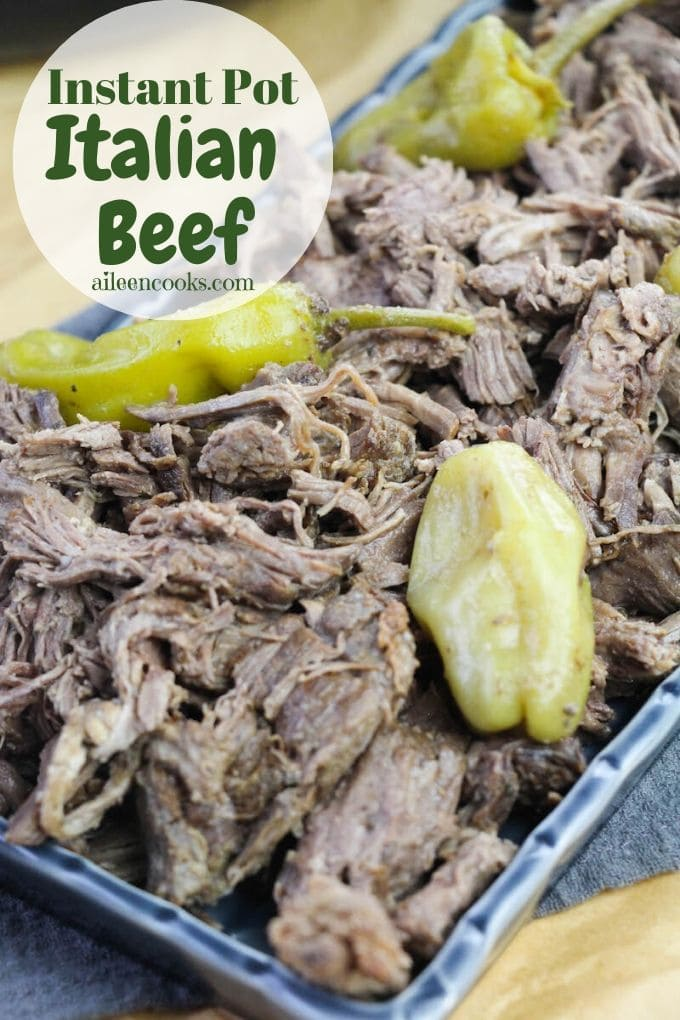 """Close up of Italian beef and the words """"instant pot Italian beef"""" in green."""