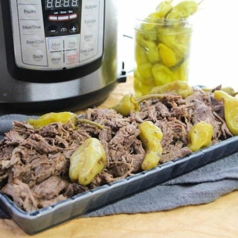 A platter of Italian beef in front of instant pot.