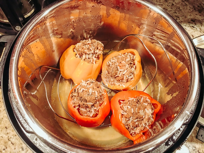 Cooked stuffed peppers inside instant pot.