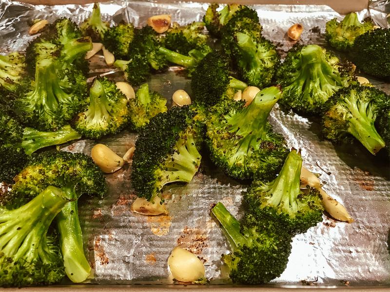 Roasted broccoli on baking sheet.