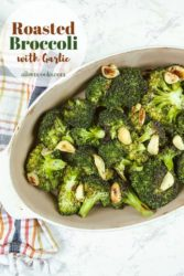 """Broccoli in serving dish with words """"roasted broccoli with garlic aileencooks.com"""""""