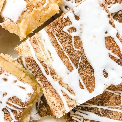 Close up of snickerdoodle bars with icing.