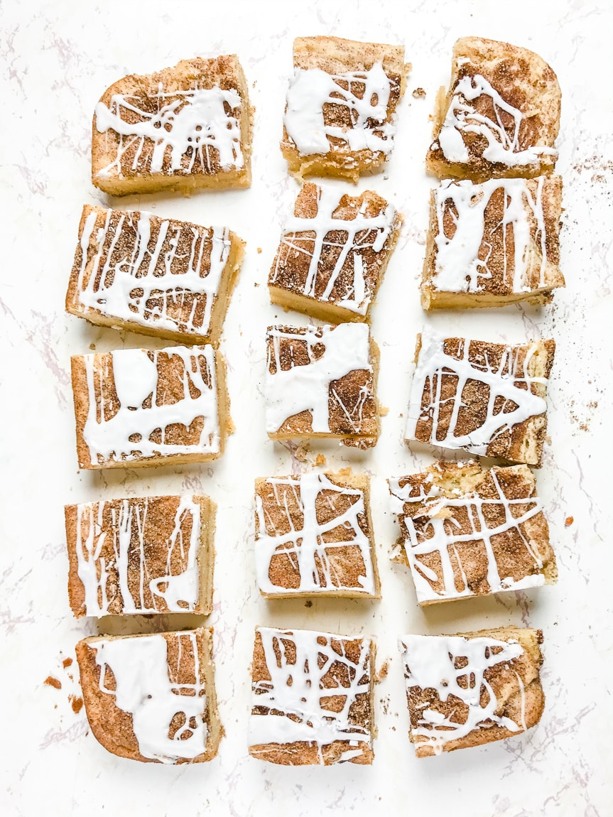 Snickerdoodle bars removed from pan and cut into squares.
