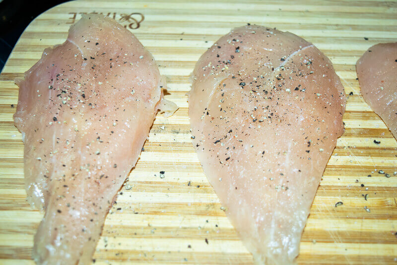 Chicken seasoned with salt and pepper.