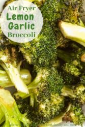 "Close up of broccoli with words ""air fryer lemon garlic broccoli"" in green letters."