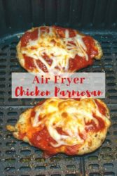 "Two slices of chicken parmesan in an air fryer with words ""air fryer chicken parmesan"" in red letters."