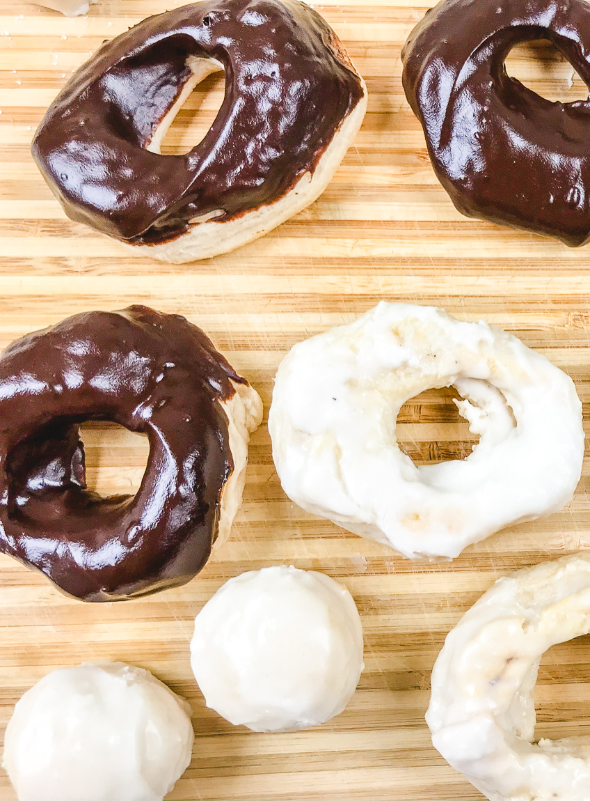 Close up of vanilla and chocolate donuts.