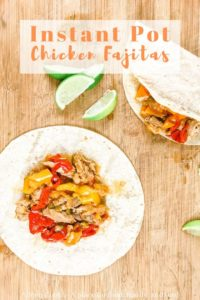 "Two fajitas on a wooden cutting board with words ""instant pot chicken fajitas"" in orange writing."
