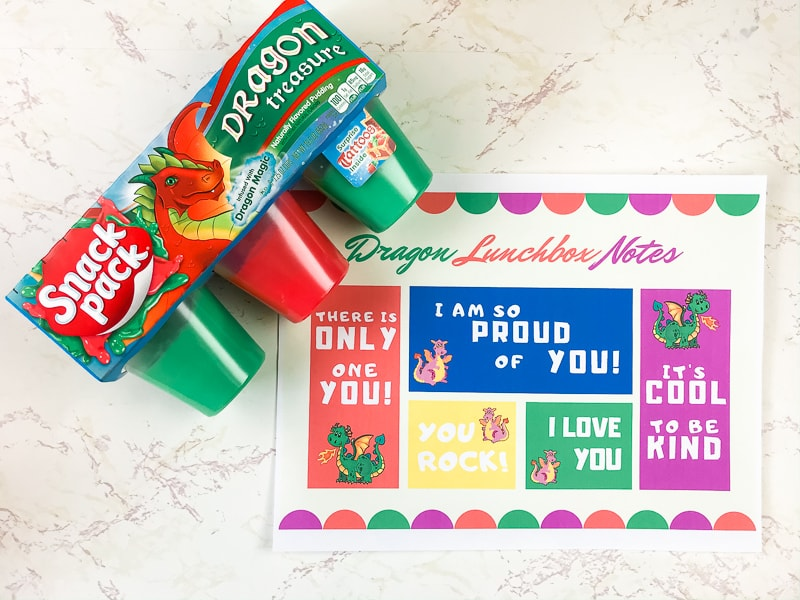 Dragon-themed printable lunchbox notes next to dragon snack pack package.