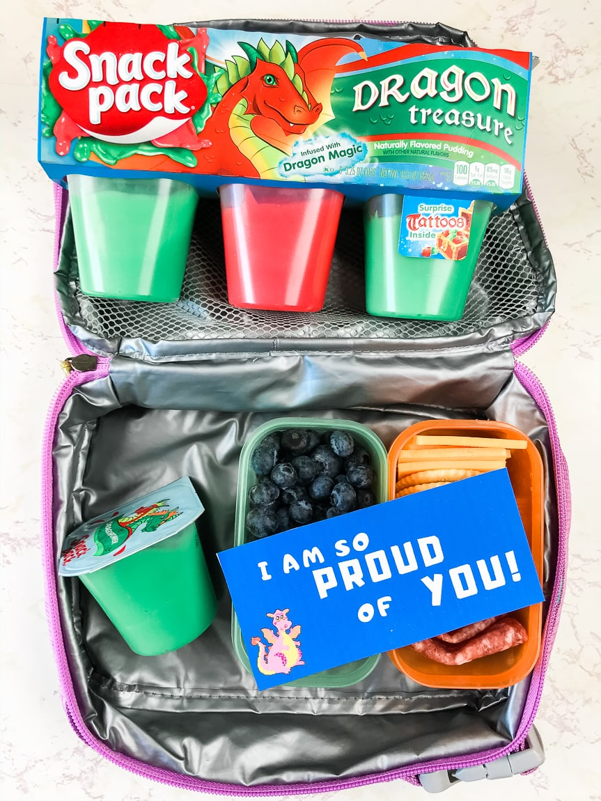 Package of snack packs next to lunchbox with blue lunch box note.