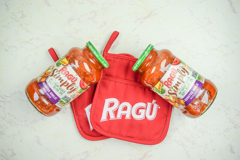 Two jars of RAGU sauce next to a red pot holder with the word RAGU on it.