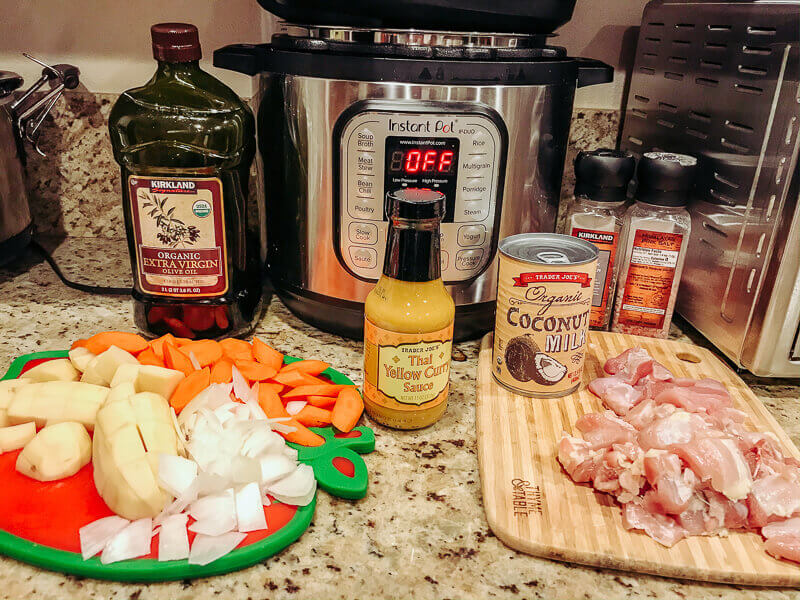 Ingredients for instant pot chicken curry on counter.