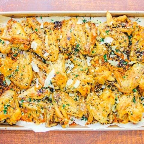 Baking sheet of crispy garlic parmesan wings.