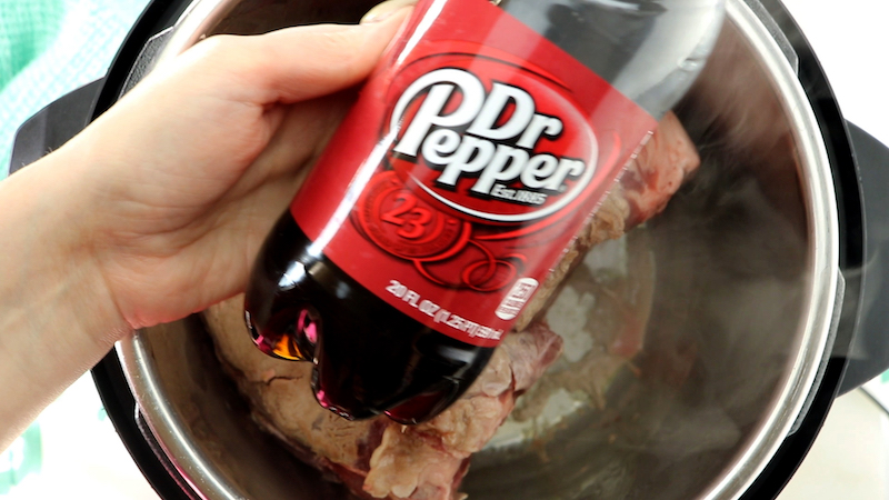 Dr. Pepper being poured into instant pot.