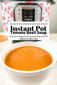 """Bowl of tomato soup in front of instant pot with words """"instant pot tomato basil soup""""."""