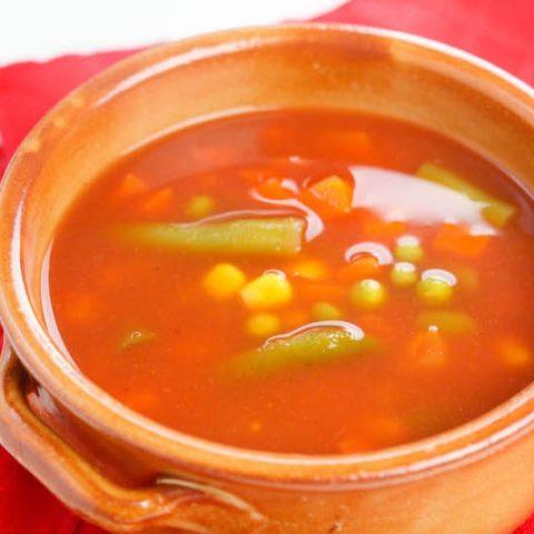 Orange bowl of vegetable soup.