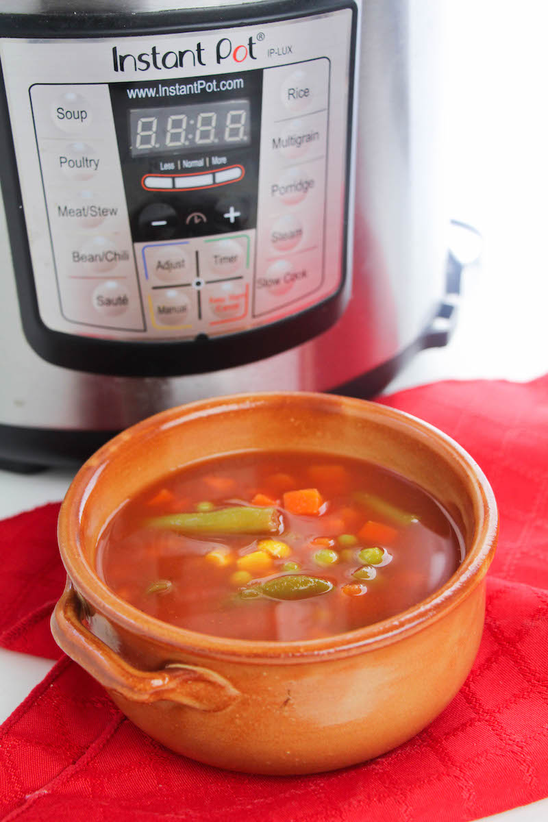 Bowl of vegetable soup in front of instant pot