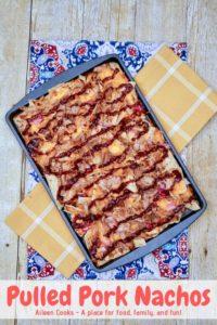 A sheet pan filled with pork nachos,.