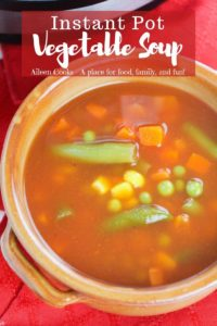 """Big bowl of vegetable soup with words """"instant pot vegetable soup"""" in red."""