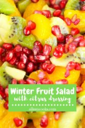 "Close up of fruit salad with words ""winter fruit salad with citrus dressing"""