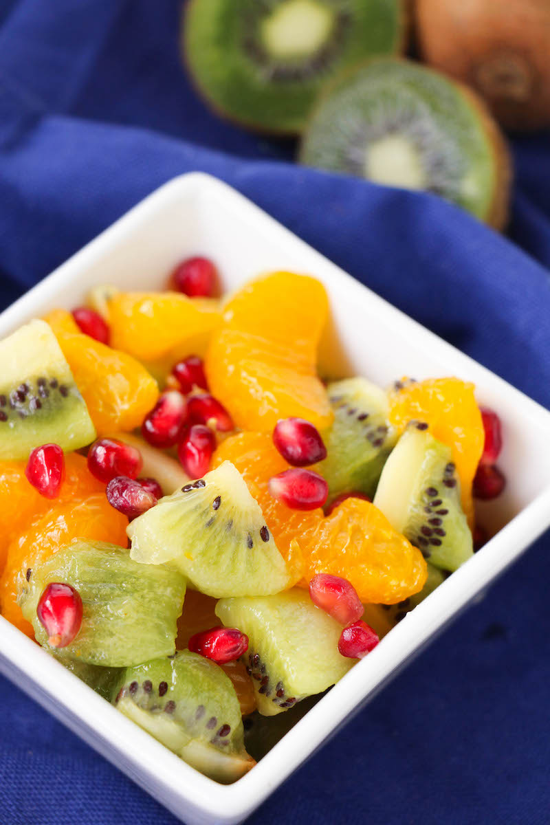 A white squares dish filled with winter fruit salad.