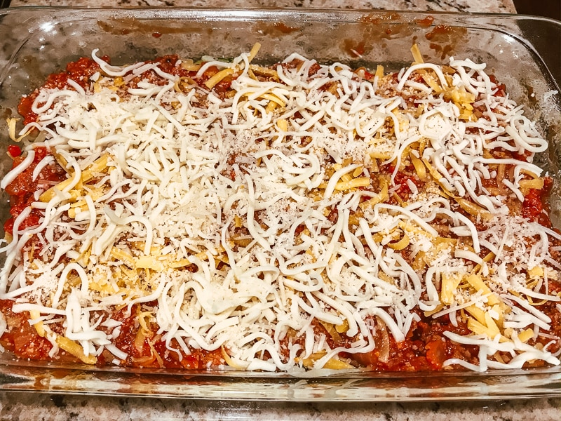 Cheese sprinkled on top of casserole.