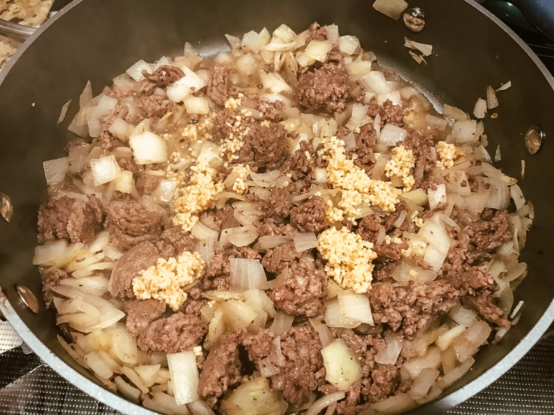 Ground beef, onion, and garlic in sauce pan.