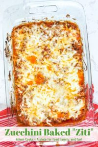 A glass casserole dish filled with zucchini baked ziti with cheese melted on top.