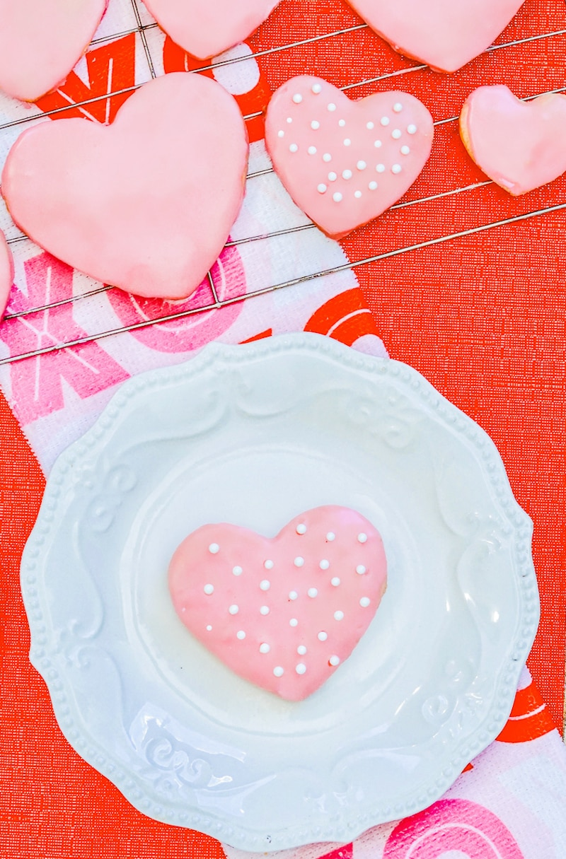 Valentine's Day cookie on a white plate.