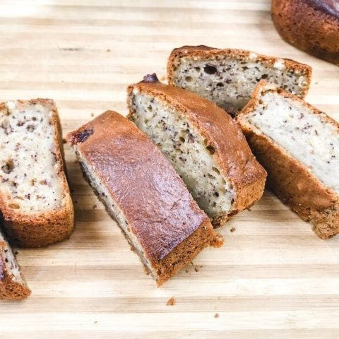 Slices of banana bread on wooden cutting board