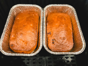 Two small loaves of banana bread in foil pans.