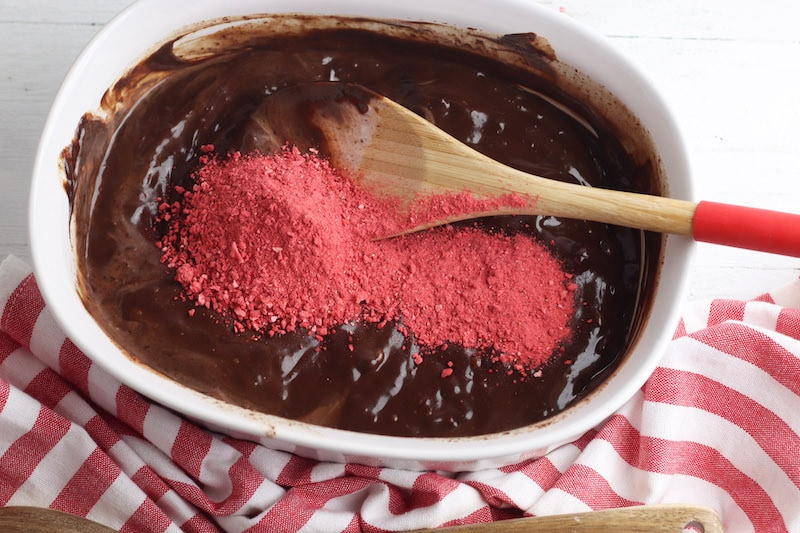 Melted chocolate with strawberry dust on top.