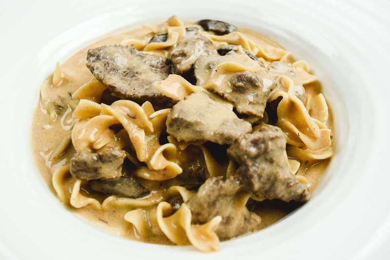 Close up of beef stroganoff with egg noodles