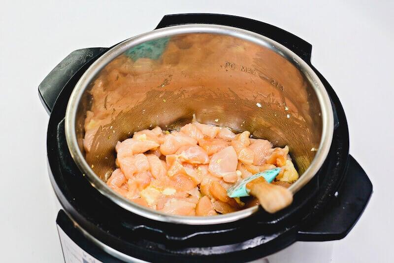 Raw chicken inside instant pot.