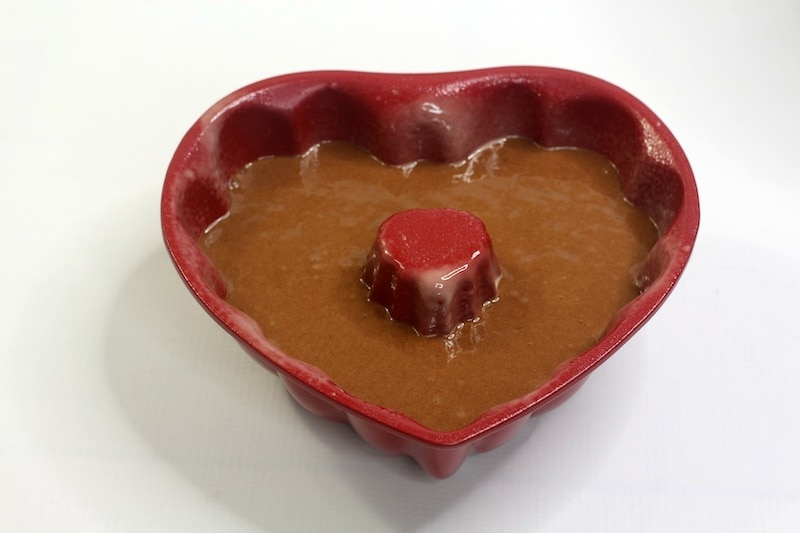 Heart shaped cake pan filled with chocolate cake batter