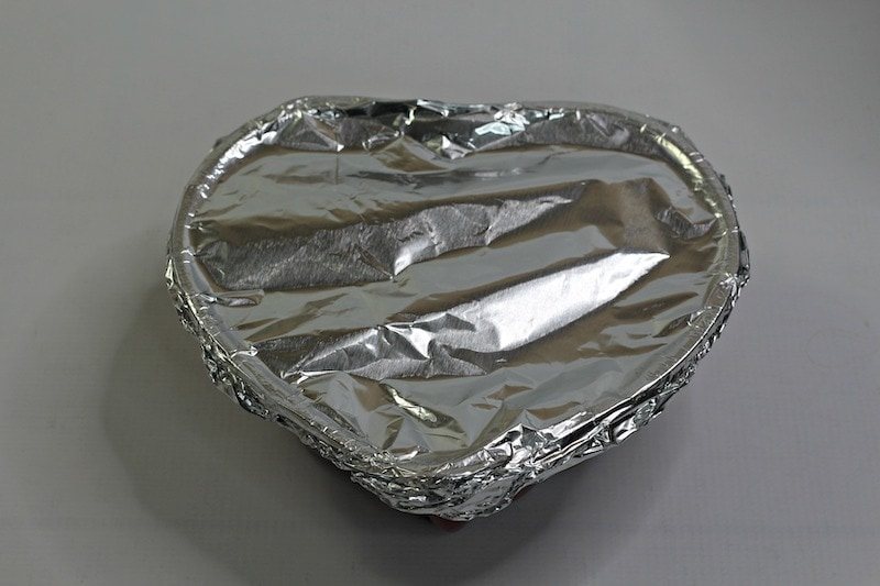Heart shaped pan covered with foil.
