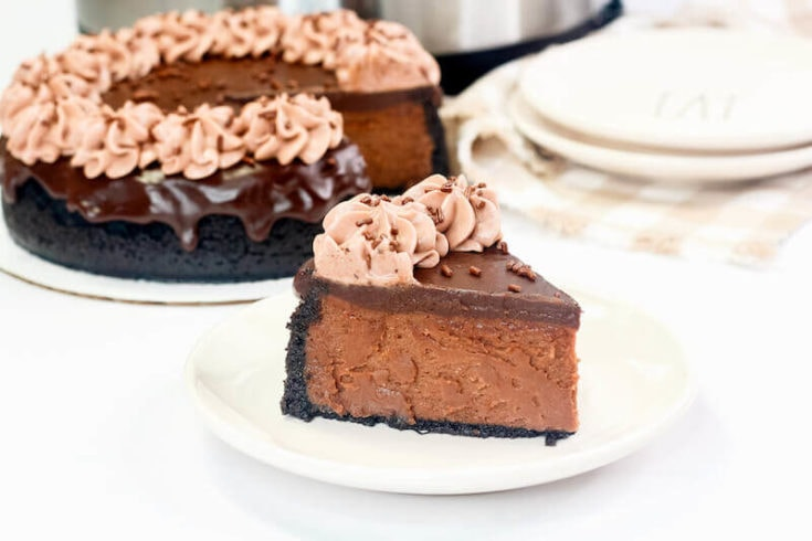 Make this decadent Instant Pot Nutella cheesecake with an Oreo cookie crust, rich chocolate ganache, and chocolate whipped cream on top.