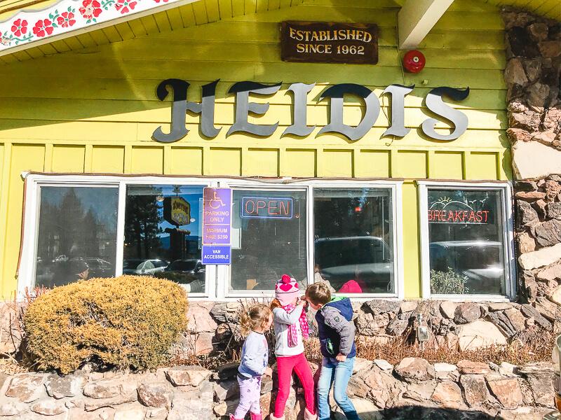 Three kids standing in front of Heidi's Pancake House in South Lake Tahoe.