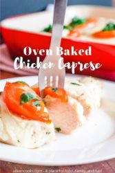 "A fork sticking into a slice of chicken caprese and the words ""oven baked chicken caprese"" in white letters."